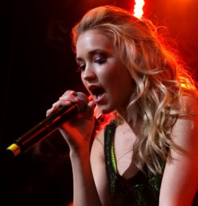 Emily Osment performing live at KISS concert in May 2010